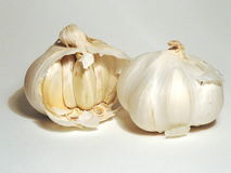 Garlic. Two garlics on a white desk Stock Images