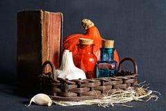 Garlic, vintage book and medical glasses Royalty Free Stock Image