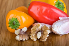 Garlic, Walnuts And Peppers / Capsicum Royalty Free Stock Photo
