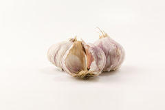 Garlic on a white background. Some heads of garlic on a white background Royalty Free Stock Photography