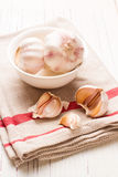 Garlic in white dish Royalty Free Stock Photo
