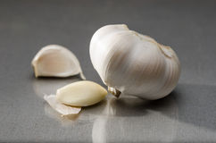 Garlic whole bulb and peeled cloves Stock Photos