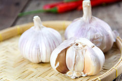 Garlic whole and cloves on wooden Royalty Free Stock Photography