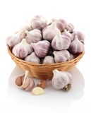Garlic in a wicker basket on a white background. Isolate Royalty Free Stock Photo