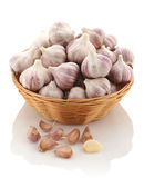 Garlic in a wicker basket on a white background. Isolate Stock Image