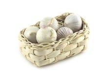Garlic in wicker basket  on white. Ripe fragrant garlic in wicker basket  on white close up Stock Photography