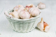Garlic in the wicker basket Royalty Free Stock Photo
