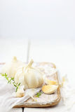 Garlic on wood board Royalty Free Stock Photography
