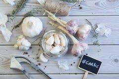 Garlic on wood Stock Images