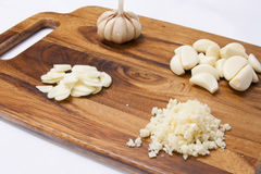 Garlic on a wood cutting board Stock Image