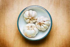 Garlic on wood table Royalty Free Stock Images