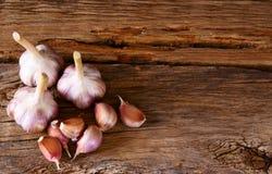 Garlic on wood. Stock Photo