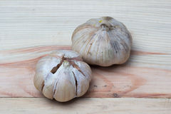 Garlic on wooden background Stock Images