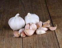 Garlic on the wooden background Royalty Free Stock Images