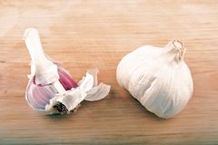 Garlic on wooden background. Bulbs of garlic on wooden surface Stock Images
