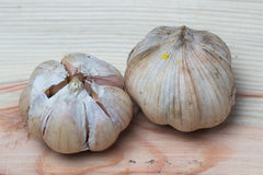 Garlic on wooden background. Garlicon a wooden background from top view royalty free stock image