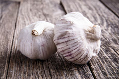 Garlic on a wooden background. Royalty Free Stock Photos