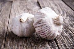 Garlic on a wooden background. Some garlics on a wooden background Royalty Free Stock Photos