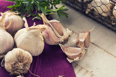 Garlic on wooden background Stock Photography