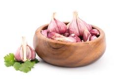 Garlic on wooden bowl.  Royalty Free Stock Photo