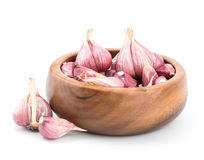Garlic on wooden bowl. Of white background Stock Photos