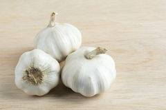 Garlic on wooden cutting boards. stock photos