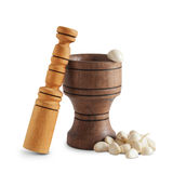 Garlic and wooden mortar. Garlic and mortar on white background Stock Photos