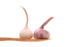 Garlic on a wooden spoon Stock Photo