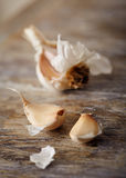 Garlic on a wooden surface. Dried garlic on a wooden surface Royalty Free Stock Photography