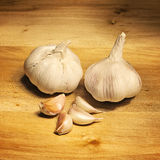 Garlic on a wooden table Stock Images
