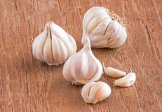 Garlic on a wooden table Royalty Free Stock Photos
