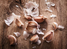 Garlic on wooden table. Garlic bulbs and cloves on wooden table, closeup stock photography