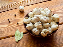 Garlic on a wooden table Royalty Free Stock Photography