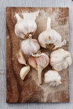 Garlic on wooden table. Royalty Free Stock Photography