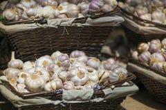 Garlic. Baskets of garlic in the market Stock Image