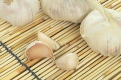 Garlics on bamboo mat Royalty Free Stock Images