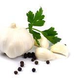 Garlics with black pepper and green parsley Stock Photography