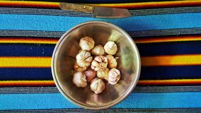 Garlics in bowl Stock Photos