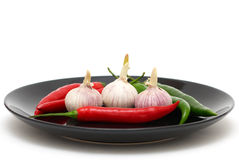 Garlics and chili peppers Stock Photography