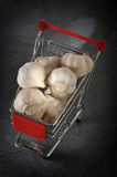 Garlics in the grocery cart Royalty Free Stock Photo