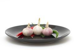 Garlics met Spaanse peperpeper Royalty-vrije Stock Afbeeldingen
