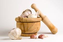 Garlics mortar Stock Photos