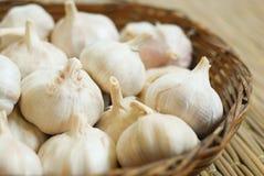 Garlics on pallet Royalty Free Stock Photos