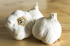 Garlics on the plank table Royalty Free Stock Images