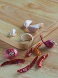 Garlics,shallots & dried chillies. Garlics, shallots & dried chillies on chopping block Stock Photography