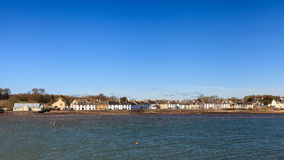 Garlieston Waterfront. The view across Garlieston Bay to the small coastal village of Garlieston in Dumfries and Galloway, Southern Scotland royalty free stock images