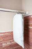 Garment bag hanging in cedar closet Stock Images