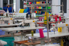 Garment factory. With no people and many tailoring tools royalty free stock images
