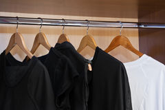 Garment on hangers. In closet Stock Photography