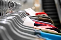 Garment hanging on hangers Royalty Free Stock Photography